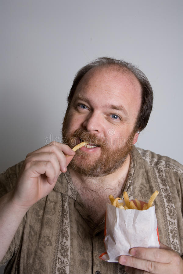 Free Obese Man Eating Fast Food Royalty Free Stock Photos - 21351618