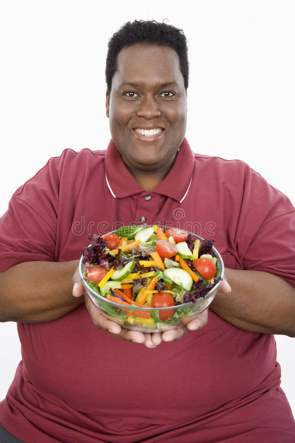 Download An Obese Man Holding Bowl Of Vegetable Salad Stock Image - Image: 29651917