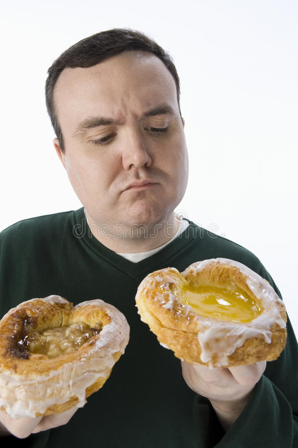 Obese Man Making A Choice Royalty Free Stock Photography