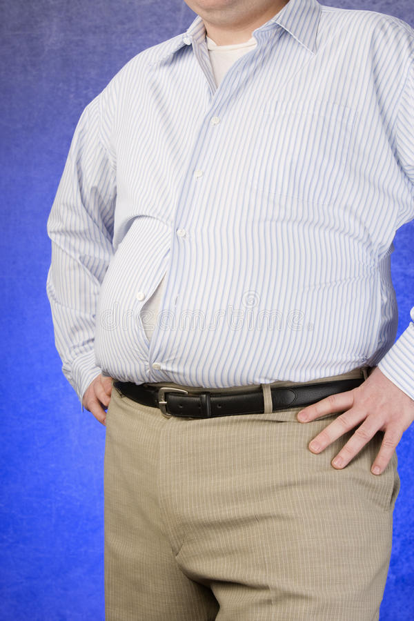 An Obese Man Standing With Hands On Hip Royalty Free Stock Photos