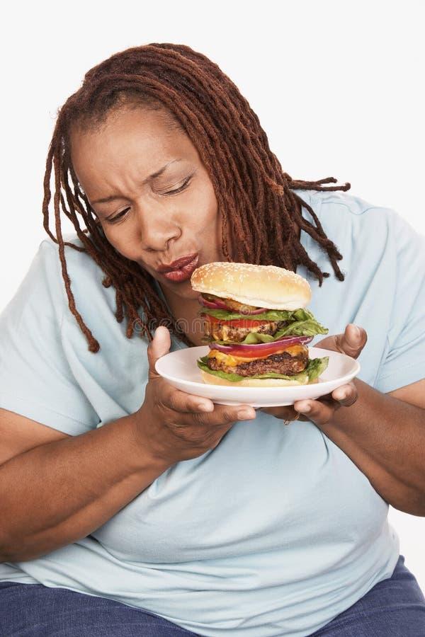 Download Obese Woman Looking At Burger Stock Photo - Image: 29651834