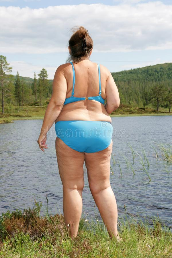 Download Obese woman by a tarn stock image. Image of sixty, fifties - 31966903