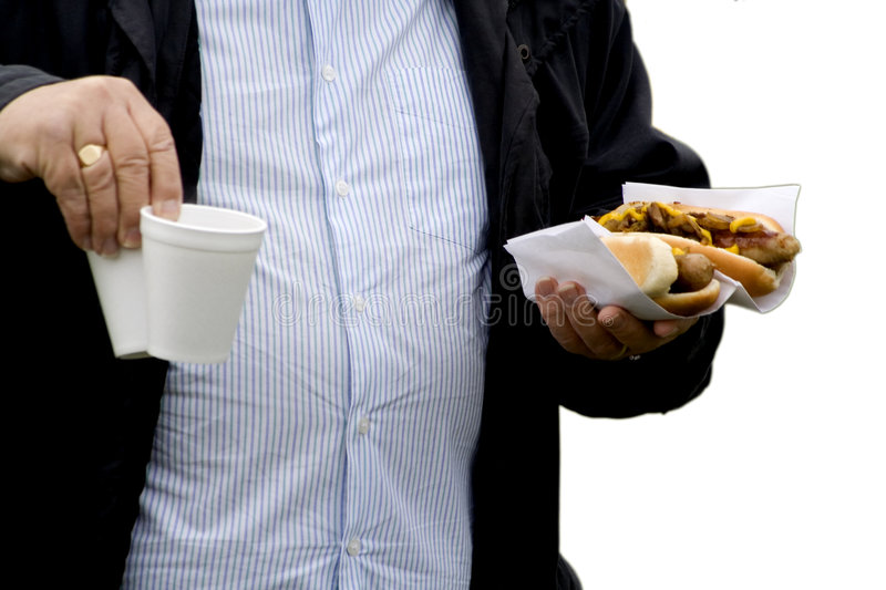 Obesity. An over weight man with fast food in his hand royalty free stock images
