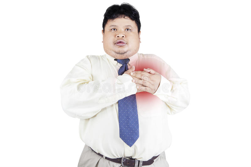 Obesity businessman getting heart attack 1. Obesity businessman getting heart attack. isolated on white background stock image