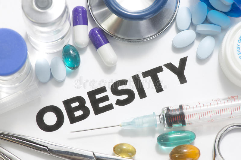 Obesity. Concept photo with pills, vials, syringe and surgical instruments stock photography
