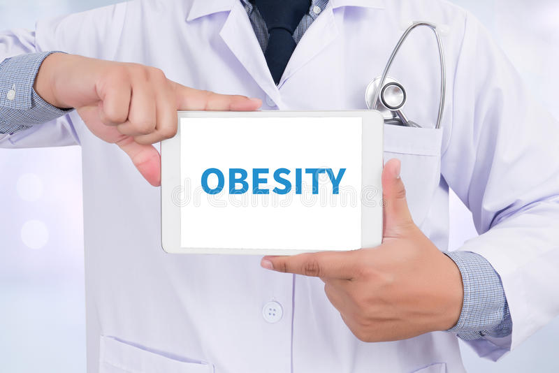 OBESITY. Doctor holding digital tablet stock photos