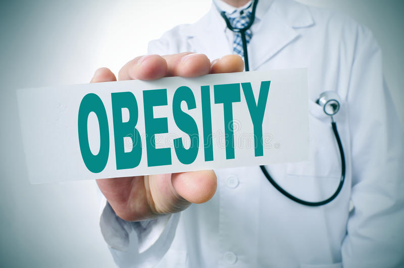 Obesity. A doctor showing a signboard with the word obesity written in it stock photos
