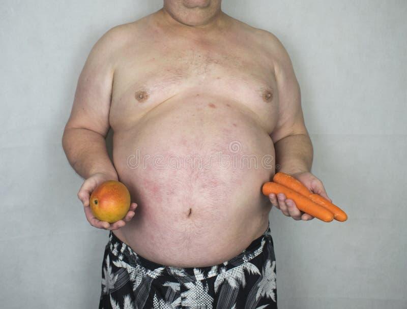 Obesity - Obese Man With Fruit & Veg royalty free stock photo
