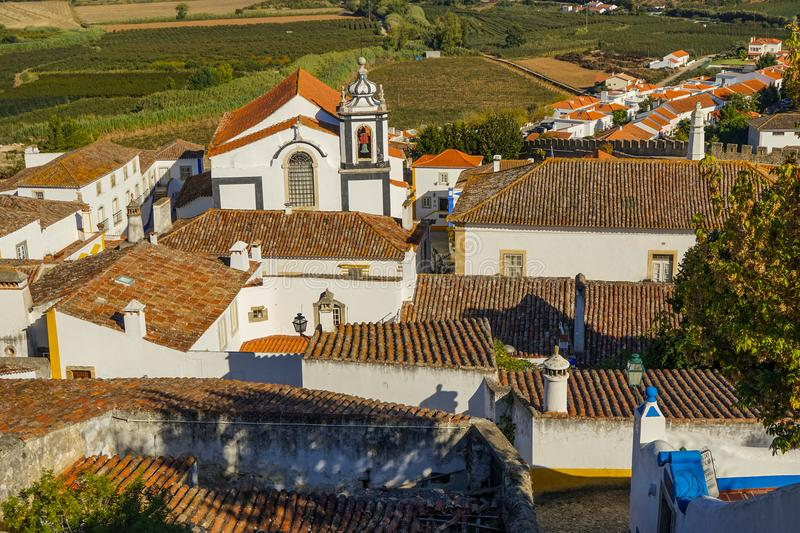 Obidos Middle Age town view. Rebuilt during 12th, 13th and 16th centuries, Middle Age walls provide nice views on town. Obidos is located in West of Portugal stock images