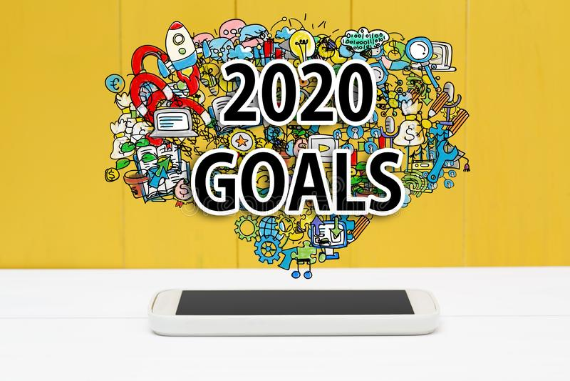 Obiettivi del 2020 con smartphone immagini stock