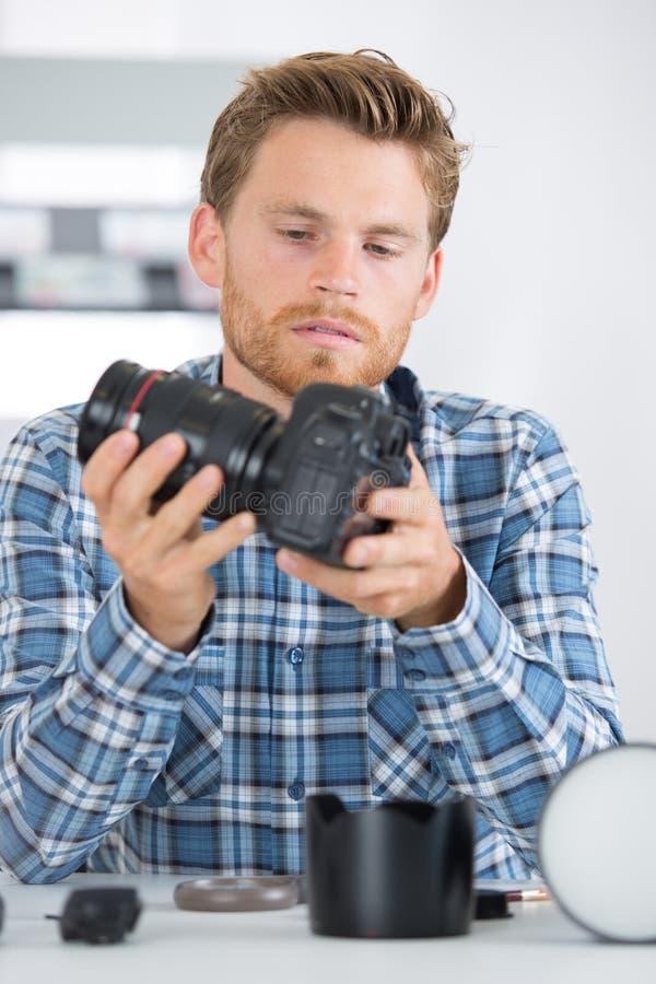 Obiettivo adatto del tecnico al corpo fotografie stock