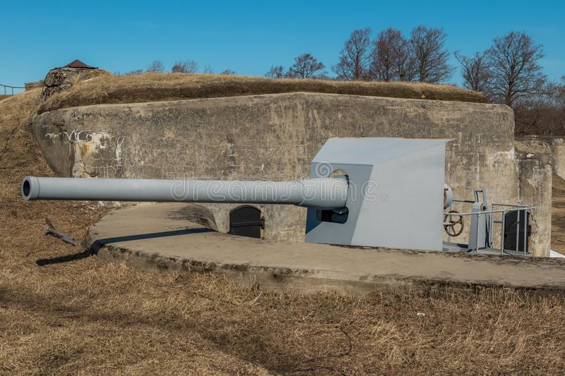 The object of cultural heritage - battery Demidov and 152 mm. guns. Russia St. Petersburg Kronstadt. Early spring. The object of cultural heritage - battery royalty free stock image