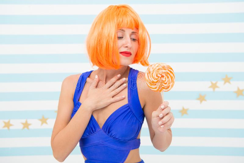 Object of desire. crazy girl looking at lollipop candy. woman with red lips holding lollipop, beauty. sugar and. Enjoying concept. beautiful pinup model with royalty free stock photography