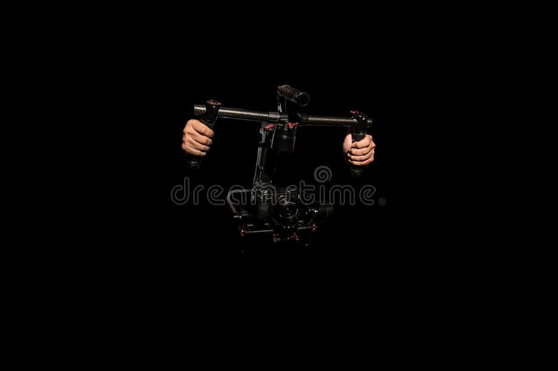 Object Ronin for smooth video production make movie . . camera stabilizer automatic . professional film maker with gimbal. Hand held shake motor system royalty free stock photography