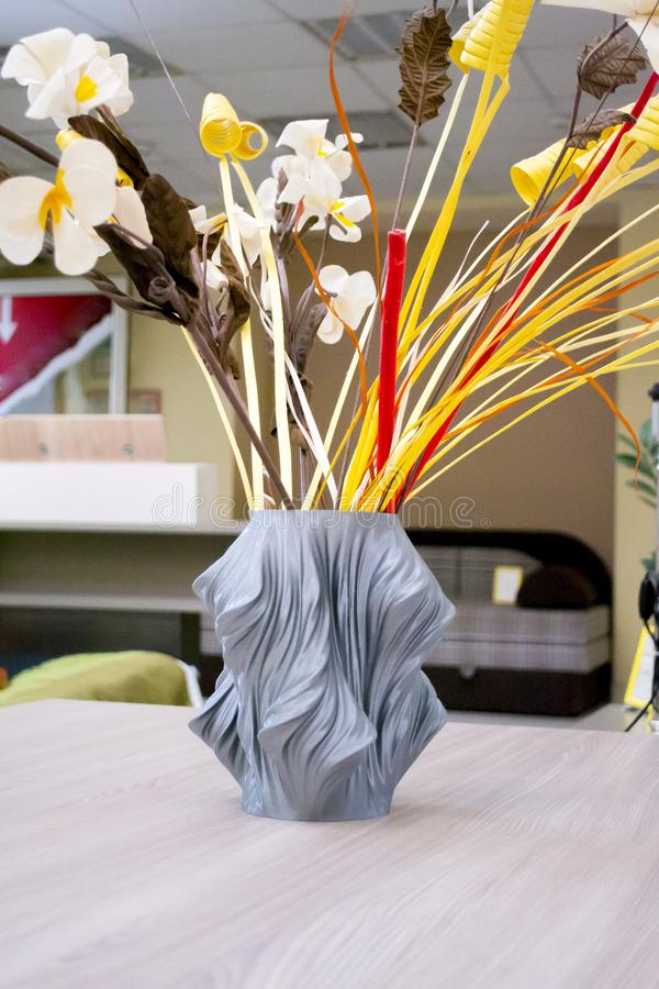 The object vase printed on the 3d printer stands on the table. Close-up. Decor vase made on a 3d printer in the interior. Progressive modern additive stock images