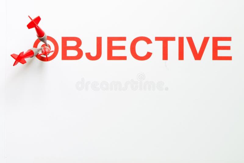 Objectieve tekst met pijltje op doel stock foto's