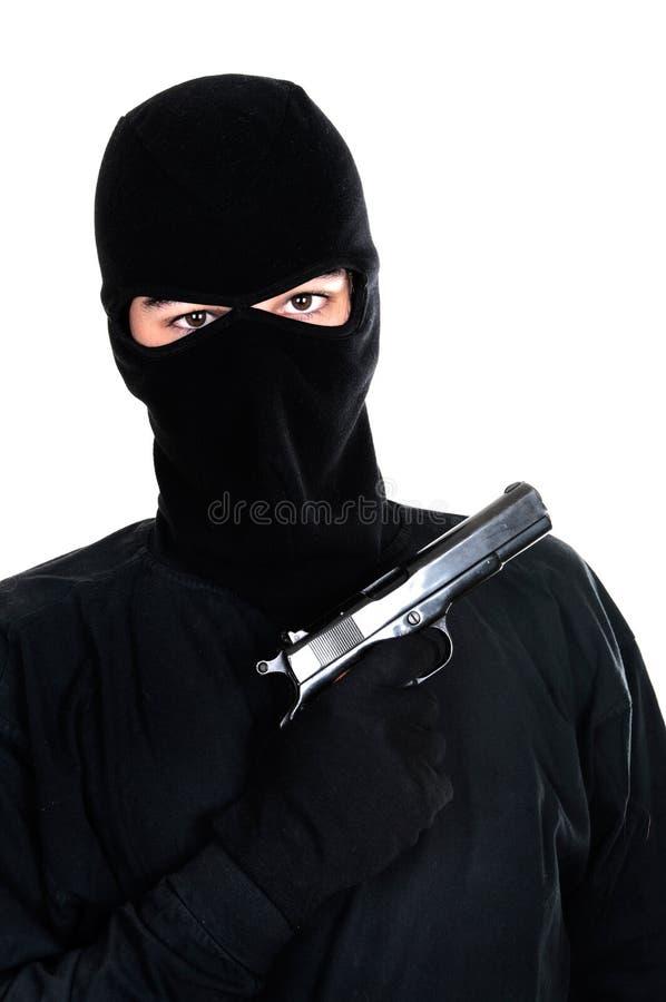 Objectifs masqués d'homme avec le canon photos stock