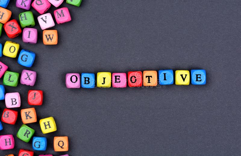 Objective word on black background royalty free stock photos