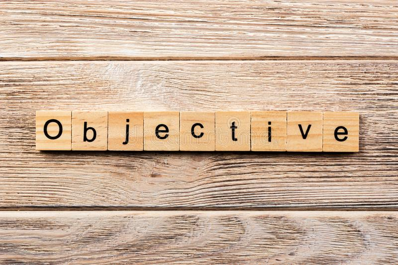 Objective word written on wood block. objective text on table, concept stock photos