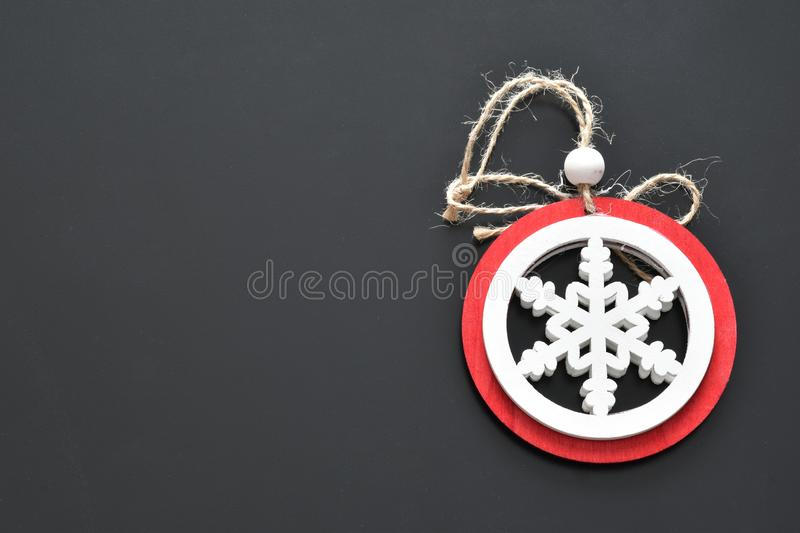 Objects for Christmas decorations snow color red and white background black. View stock photography