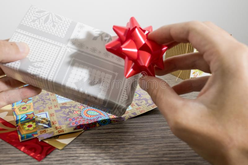 Objects for wrapping a christmas gift full of colors royalty free stock photography