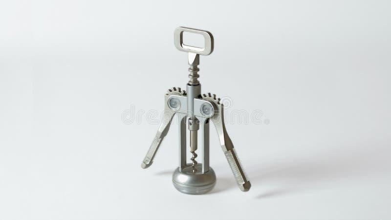 Objet métallique blanc de fond de tire-bouchon photographie stock libre de droits