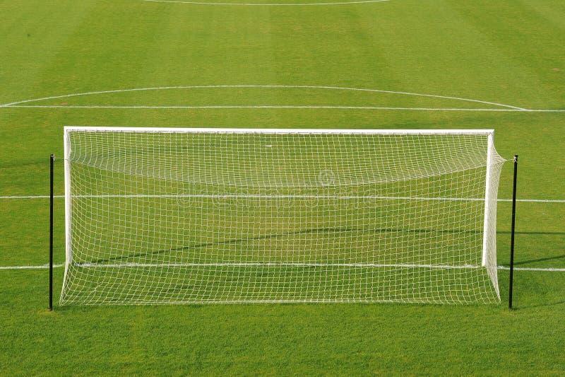 Objetivo do futebol no campo imagens de stock royalty free