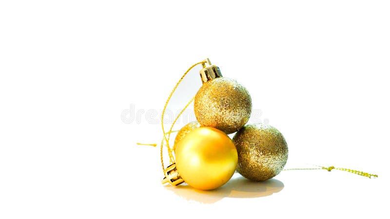 Objeto de la decoración de cuatro bolas del oro por la Navidad y el Año Nuevo imagen de archivo libre de regalías
