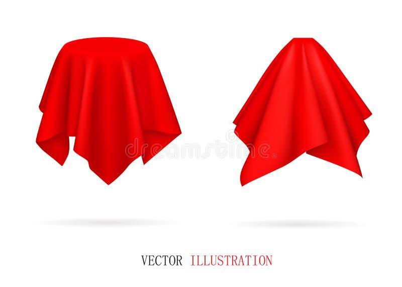 Objetos cubiertos de tela roja foto de archivo libre de regalías