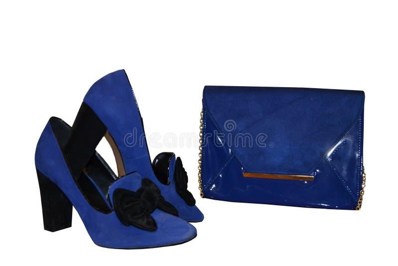 Objetos fêmeas azuis Couro envernizado e camurça da embreagem com um gol foto de stock