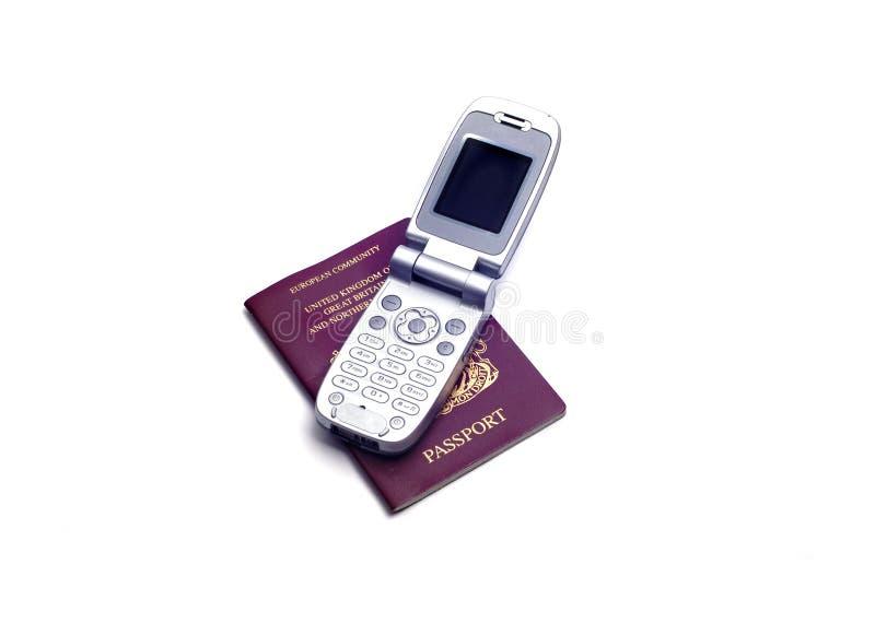 Objets - passeport et téléphone photographie stock