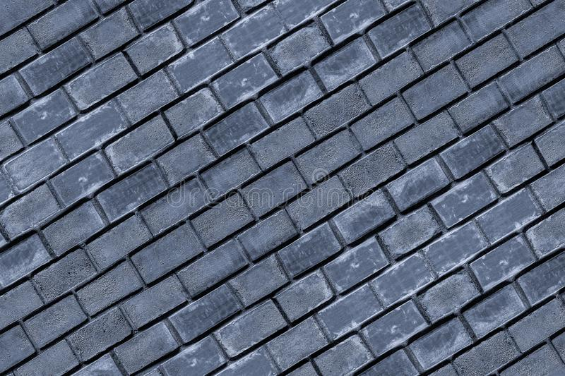 Oblique base dark blue stone background row of bricks part of the surface city wall base design royalty free stock photography