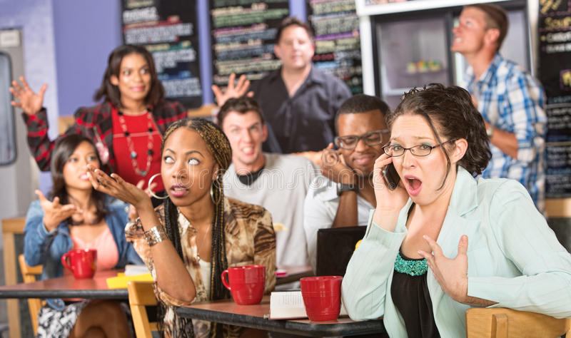 Obnoxious Customer on Phone. Group of people annoyed with obnoxious person on phone stock photos
