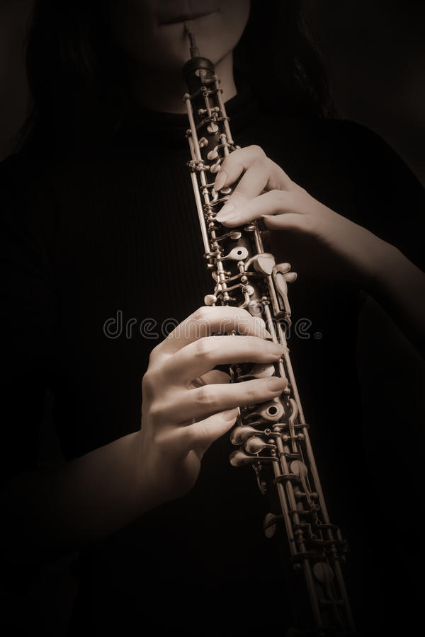 Oboe player. Hands with Music instrument closeup. Oboe player. Hands with Music instrument. Classical musician oboist closeup royalty free stock photo