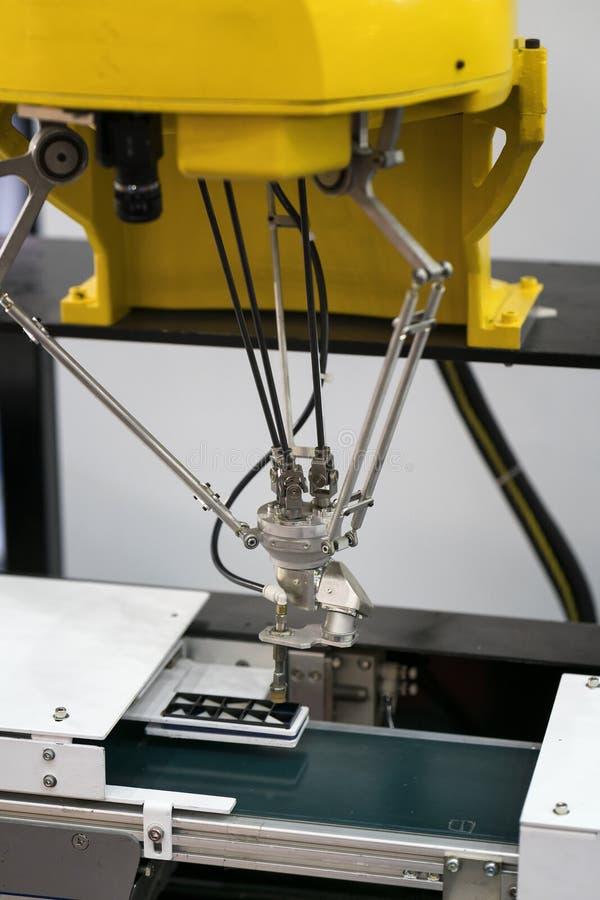Obot e sistema di automazione per fabbricazione moderna fotografia stock