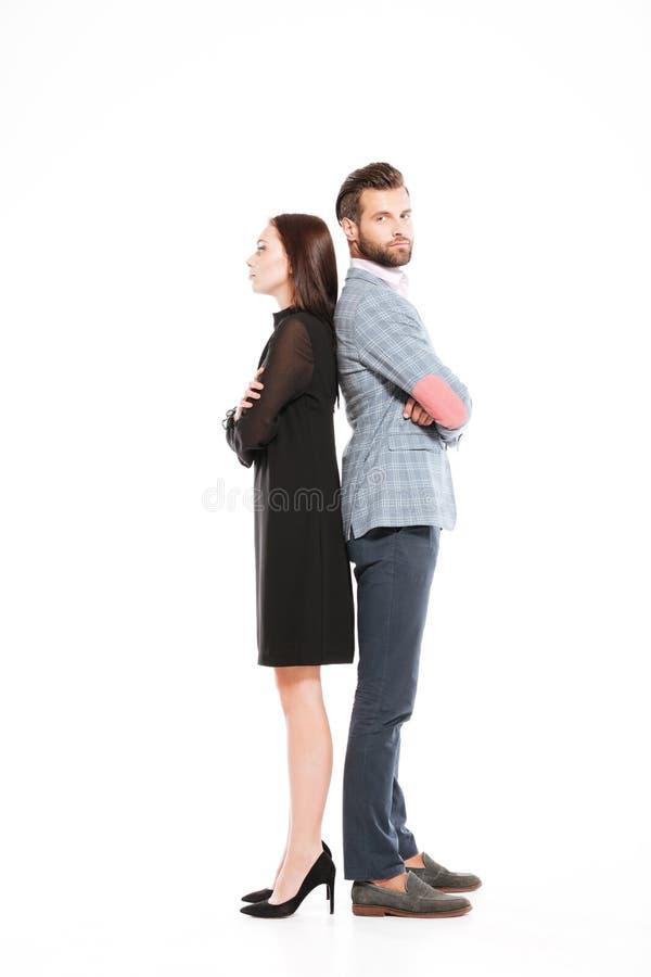 Obrażająca kochająca pary pozycja odizolowywająca zdjęcie royalty free