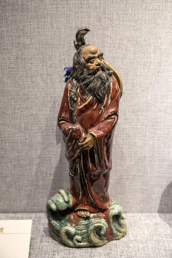 Obras de arte hechas de escultura de cerámica en Guangdong, Foshan y Shiwan fotos de archivo