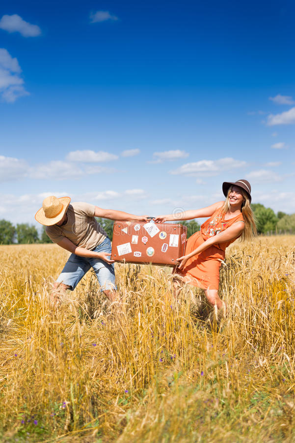 Obrazek żeński i męski mienie pakuje wpólnie fotografia stock