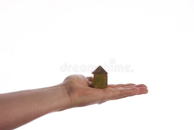 Obrazek mężczyzna ręki mienia model drewniany dom fotografia stock