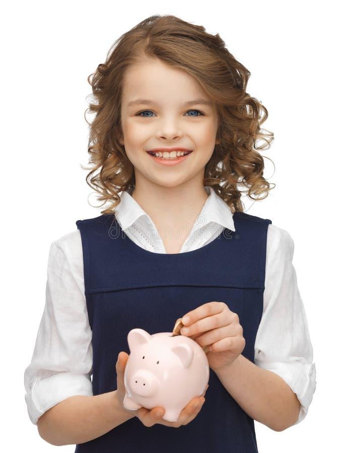 Dziewczyna z prosiątko bankiem zdjęcie stock