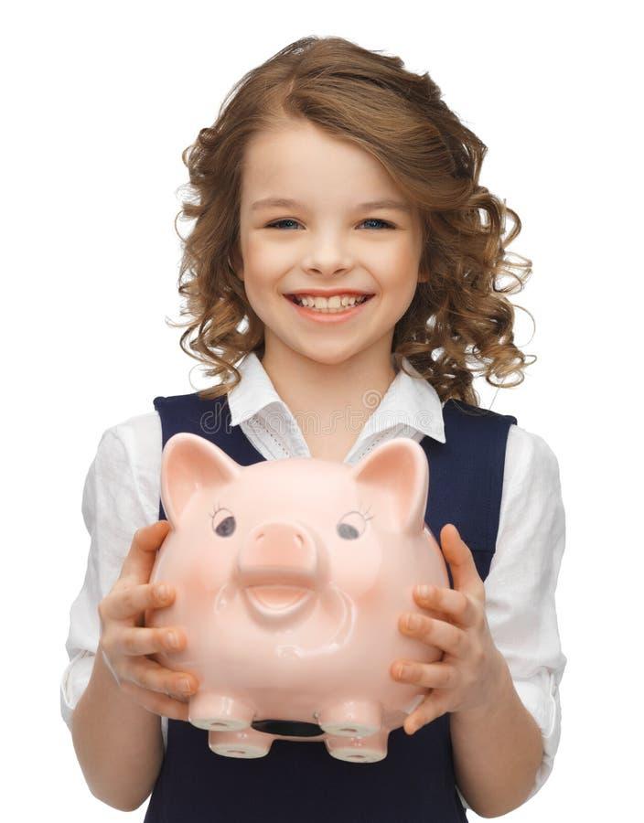 Dziewczyna z prosiątko bankiem obraz stock