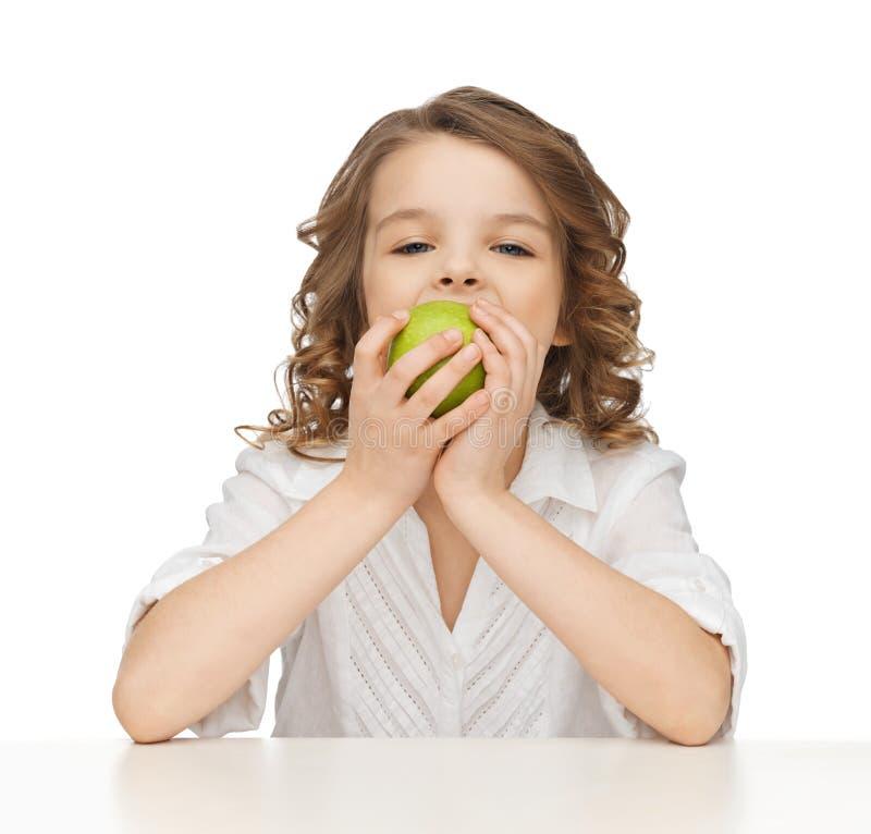 Dziewczyna z zielonym jabłkiem zdjęcie stock