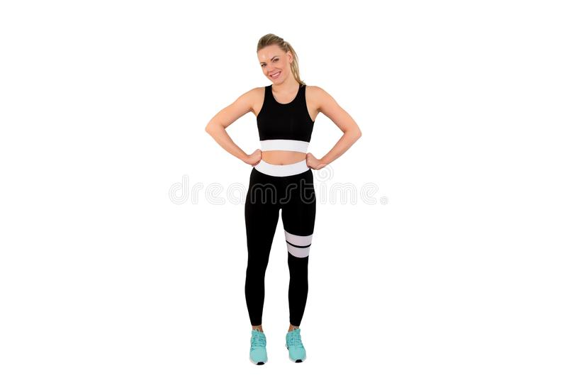 Obrazek piękna sportowa kobieta w sportswear pozować odizolowywam na białym tle - Wizerunek obraz stock