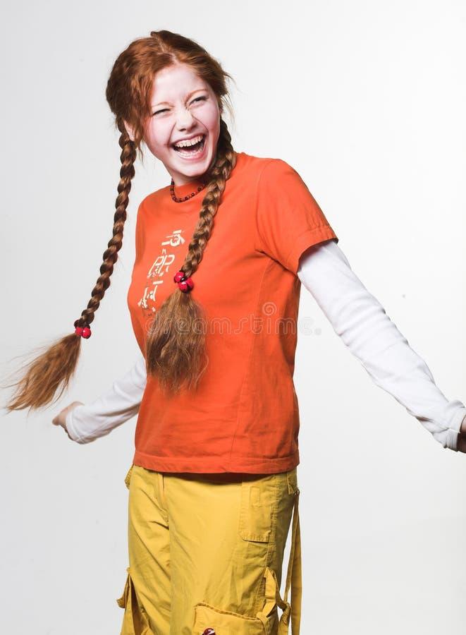 Obrazek urocza rudzielec dziewczyna z długimi warkoczami zdjęcia royalty free