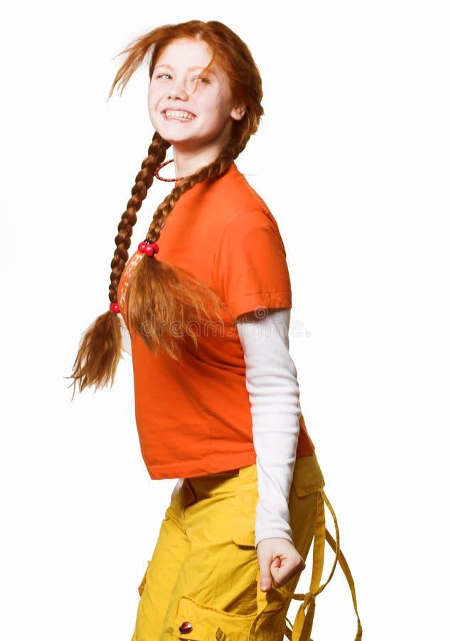 Obrazek urocza rudzielec dziewczyna z długimi warkoczami zdjęcia stock