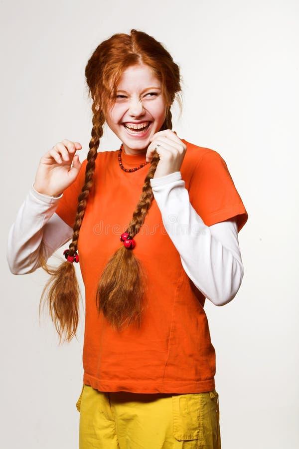 Obrazek urocza rudzielec dziewczyna z długimi warkoczami obraz royalty free