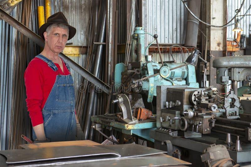 Obrero, maquinista, máquinas, trabajo industrial fotografía de archivo