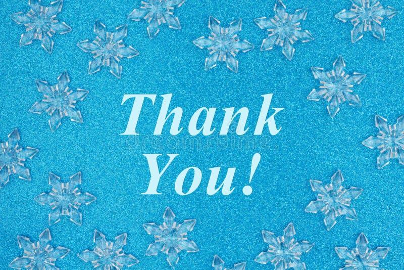 Obrigado mensagem com flocos de neve imagens de stock royalty free
