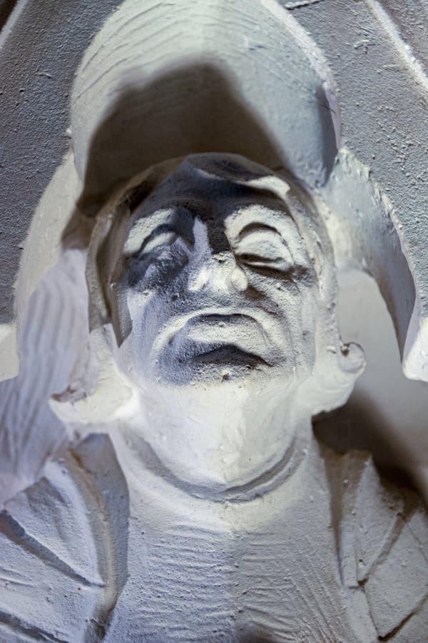 Obsługuje głowę rzeźbiącą w kamieniu zdjęcia royalty free