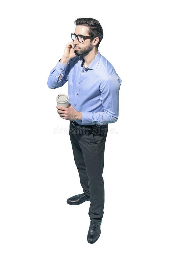 Obsługuje mieć kawową przerwę i opowiadać na telefonie zdjęcie royalty free